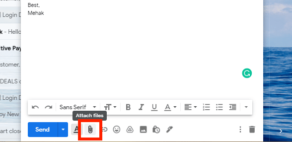 Click the attach files icon in Gmail